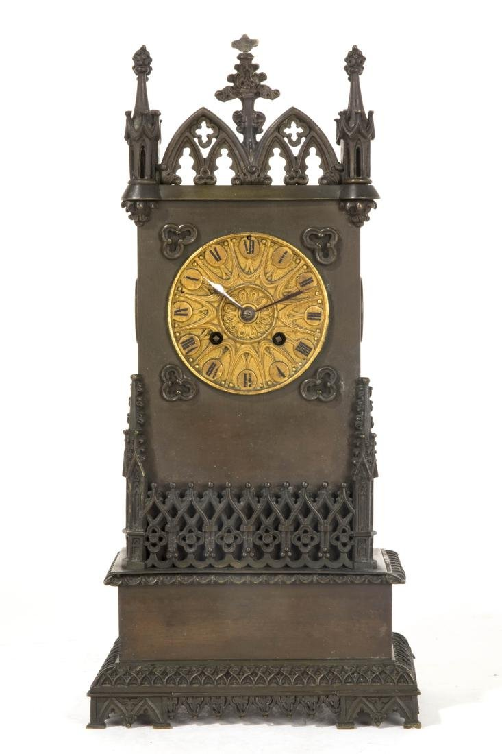 A French Gothic Revival bronze mantel clock