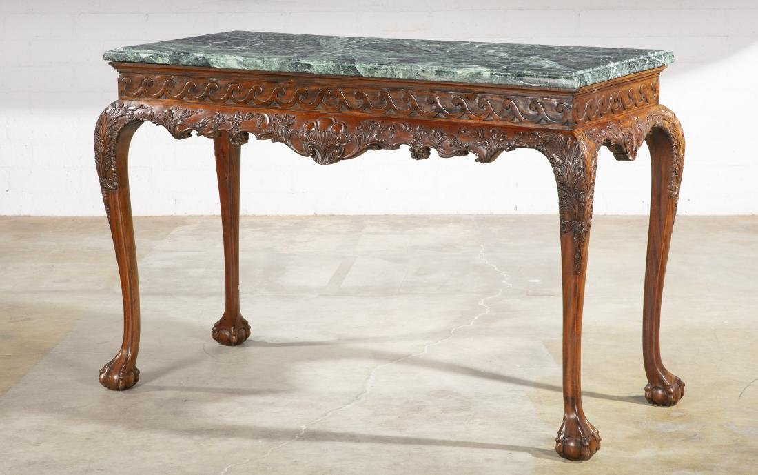 A George II style carved mahogany side table