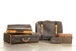 Four Louis Vuitton monogram canvas travel bags