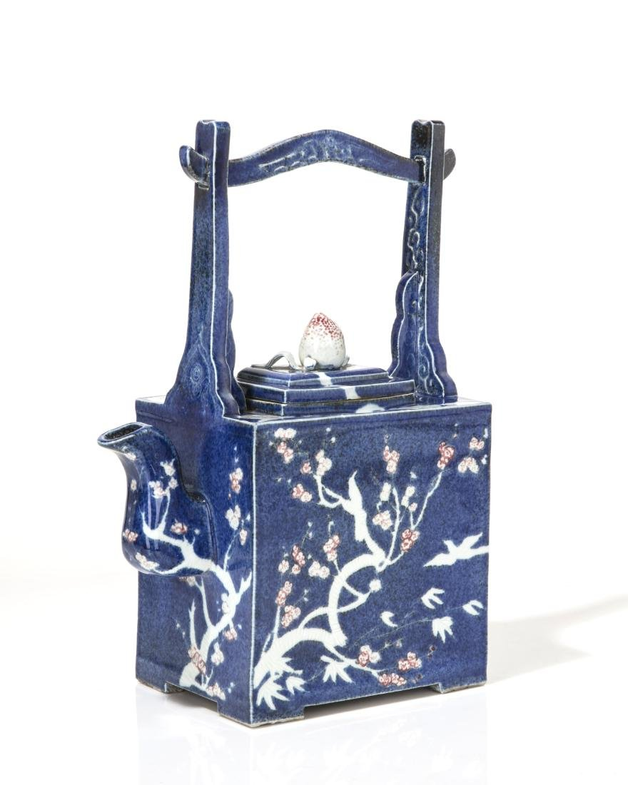 An oversized Japanese blue glazed ceramic teapot