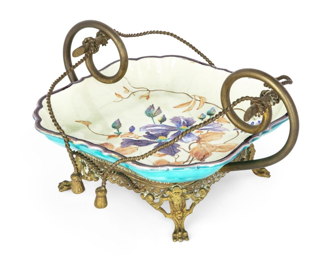 A French metal mounted Gien faience centerpiece