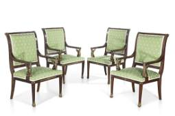 A set of four Empire style mahogany armchairs