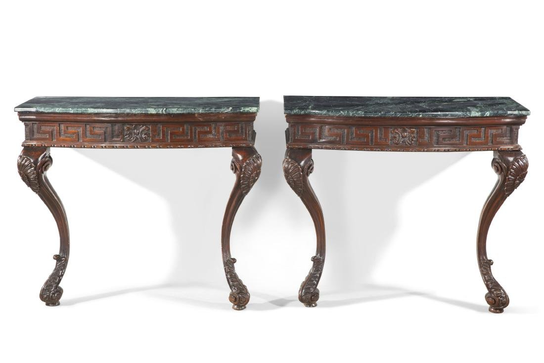 A pair of George II style mahogany consoles