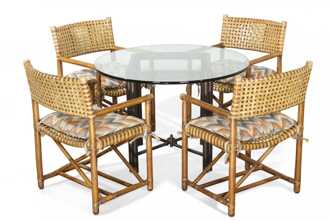 A set of four McGuire armchairs a table