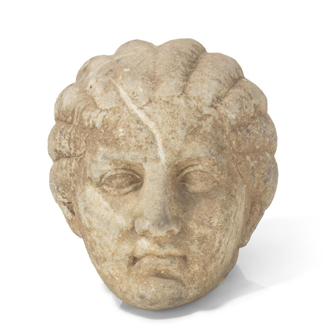 A carved marble head of a woman, possibly Ancient