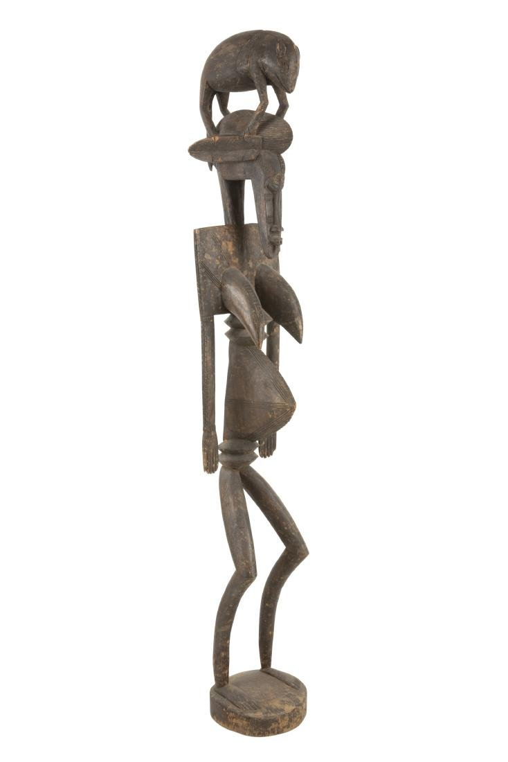 An African carved wood Dogon figure of a woman