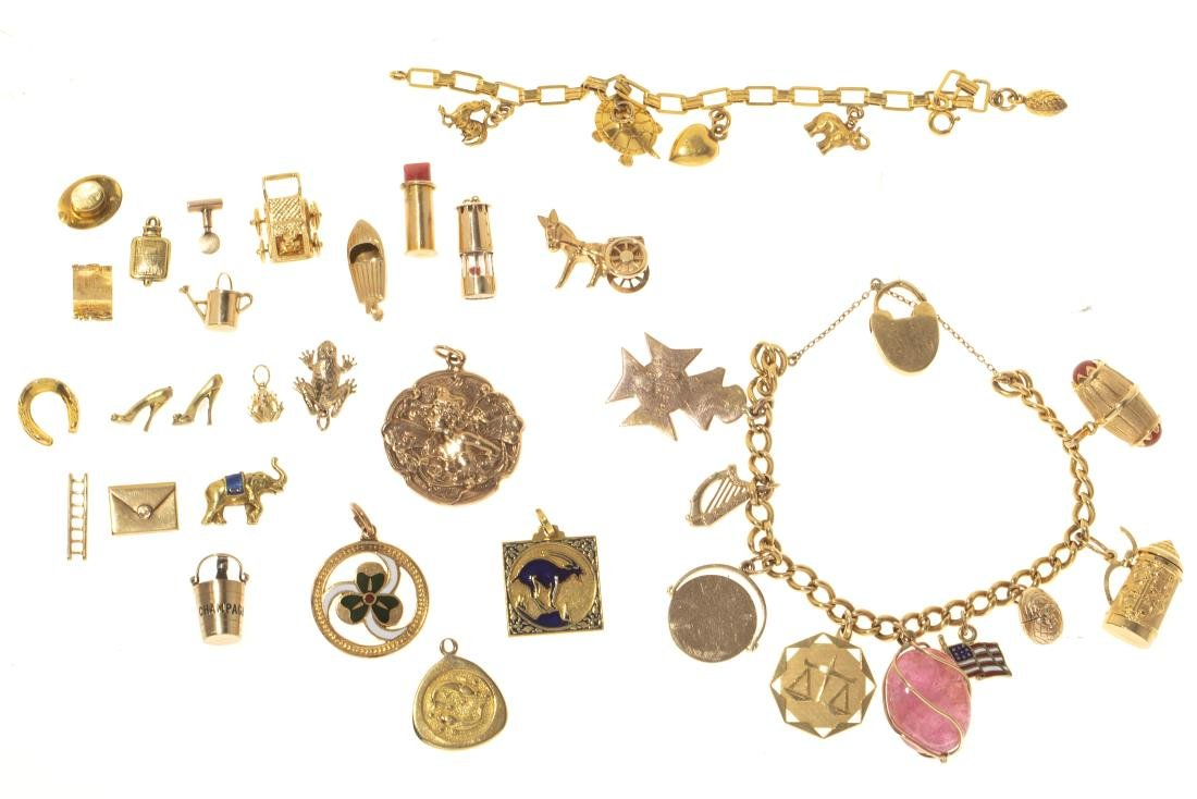 Collection of gold charm bracelets & charms