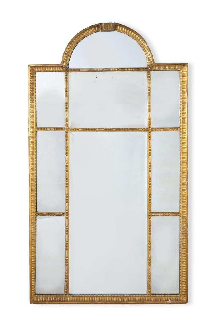 A Continental Neoclassical style giltwood mirror
