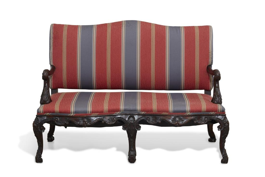 A Continental Rococo carved mahogany settee
