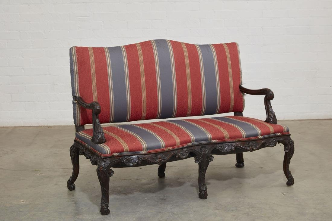 A Continental Rococo carved mahogany settee - 2