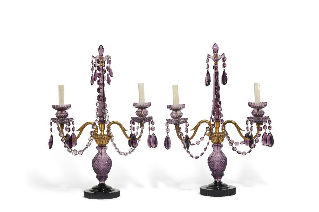 A pair of Bohemian amethyst glass girandoles