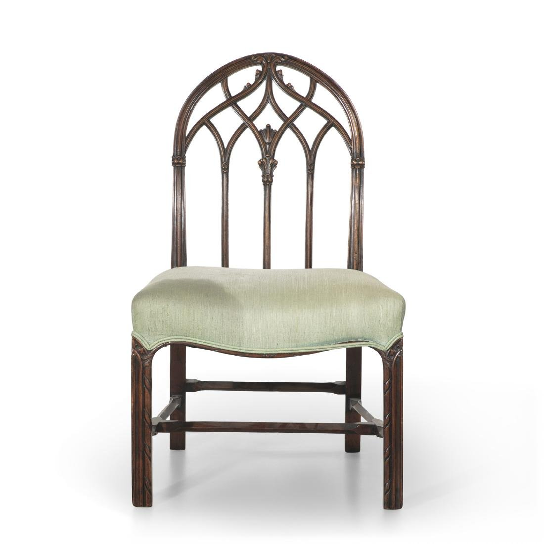 A Gothic Revival carved mahogany side chair