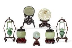 A group of seven Chinese carved jade table decorations