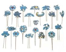 Group of Asian feather & metalware hair pins