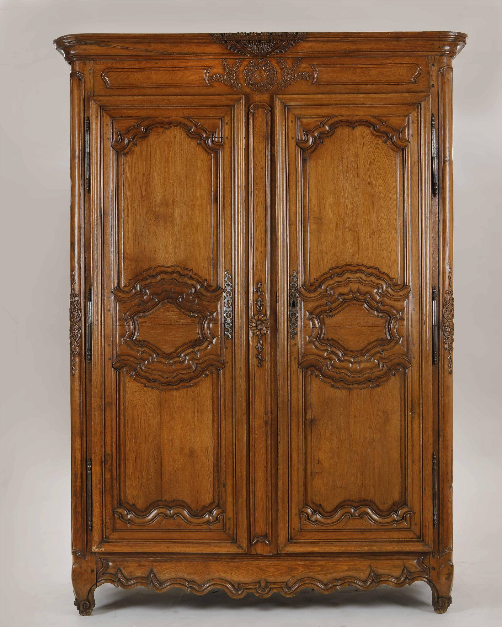 A French Provincial carved oak armoire