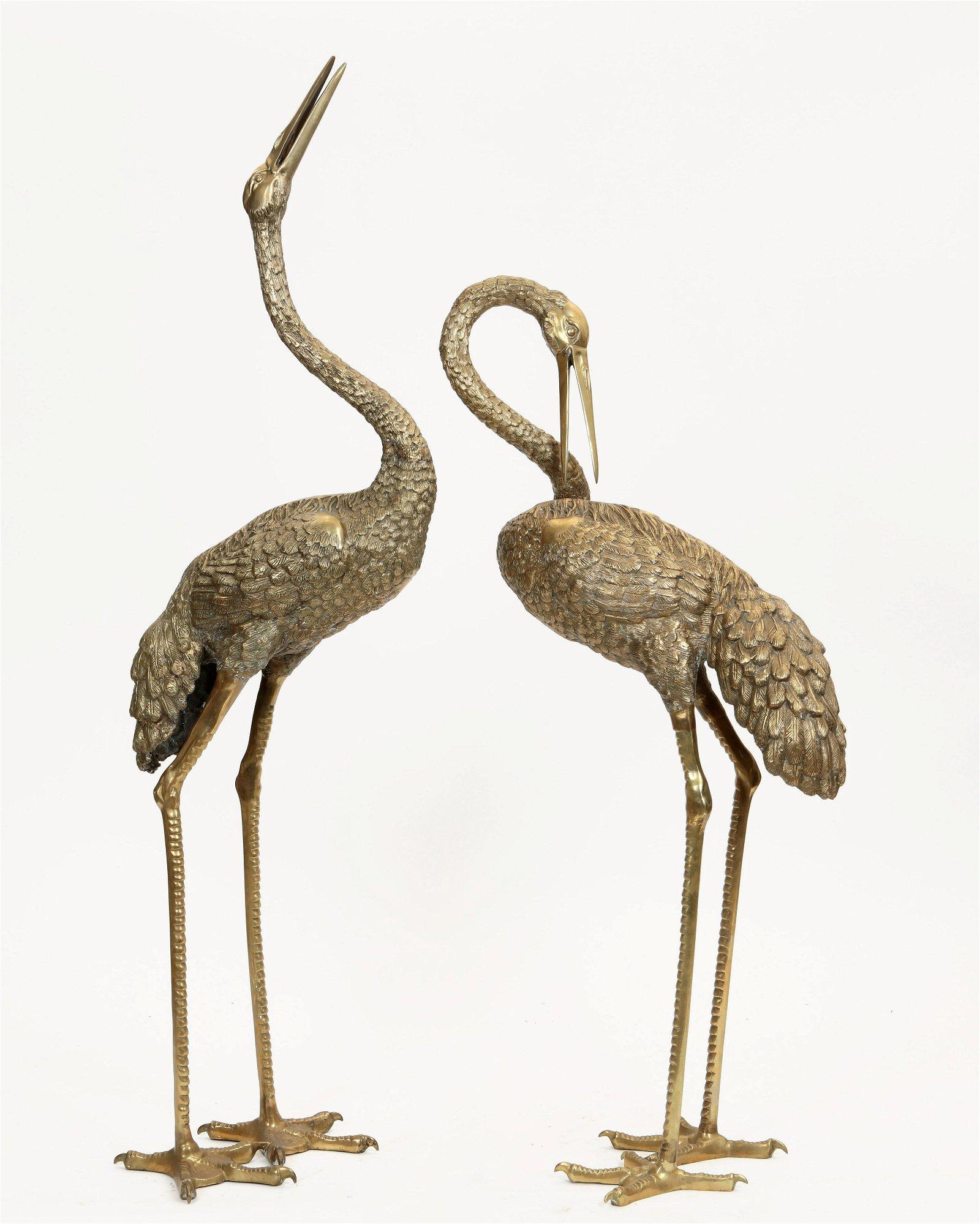 Pair of life size Asian bronze figures of cranes