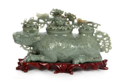 A Chinese green hardstone ox form box
