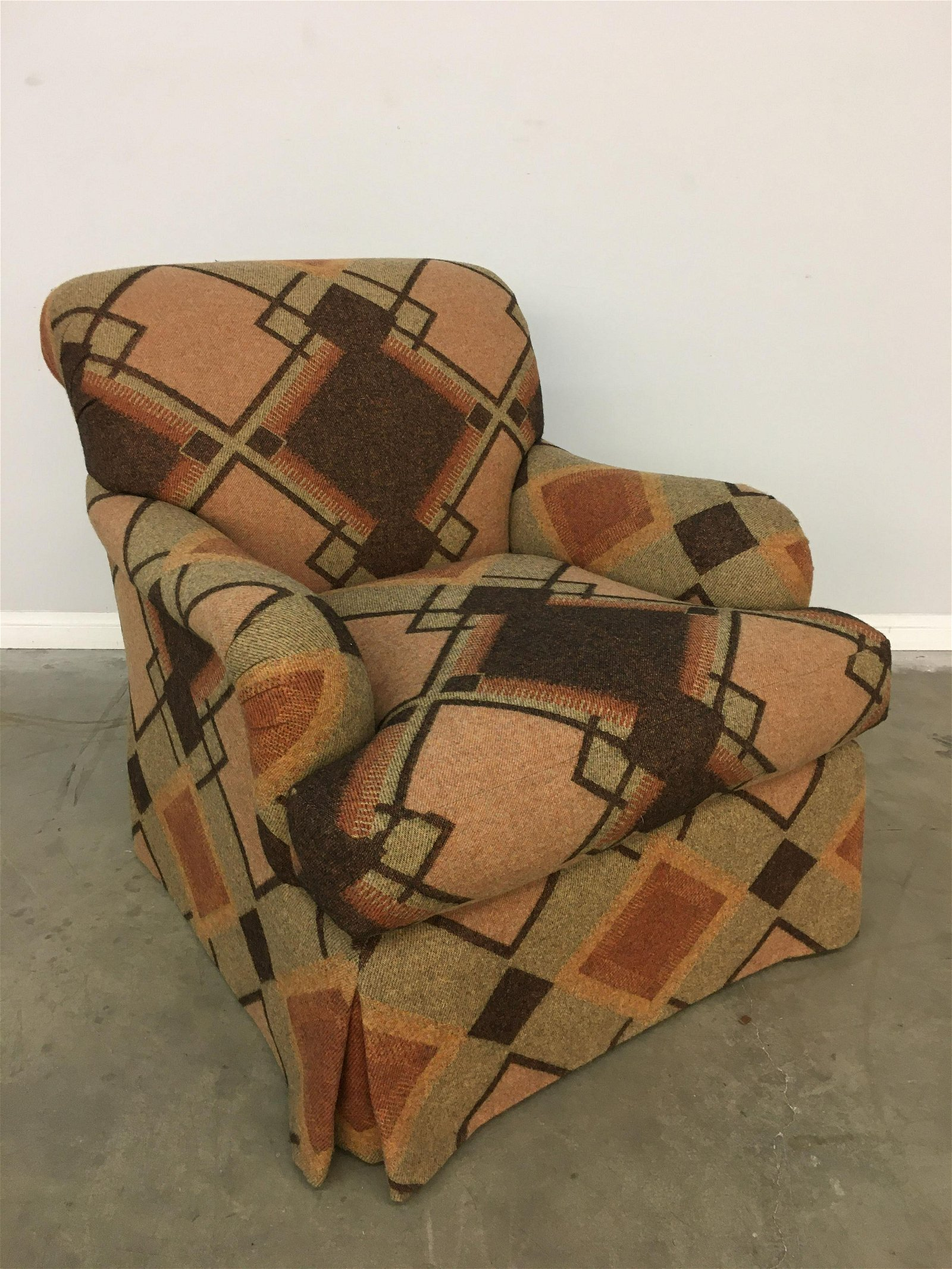 A fully upholstered club armchair