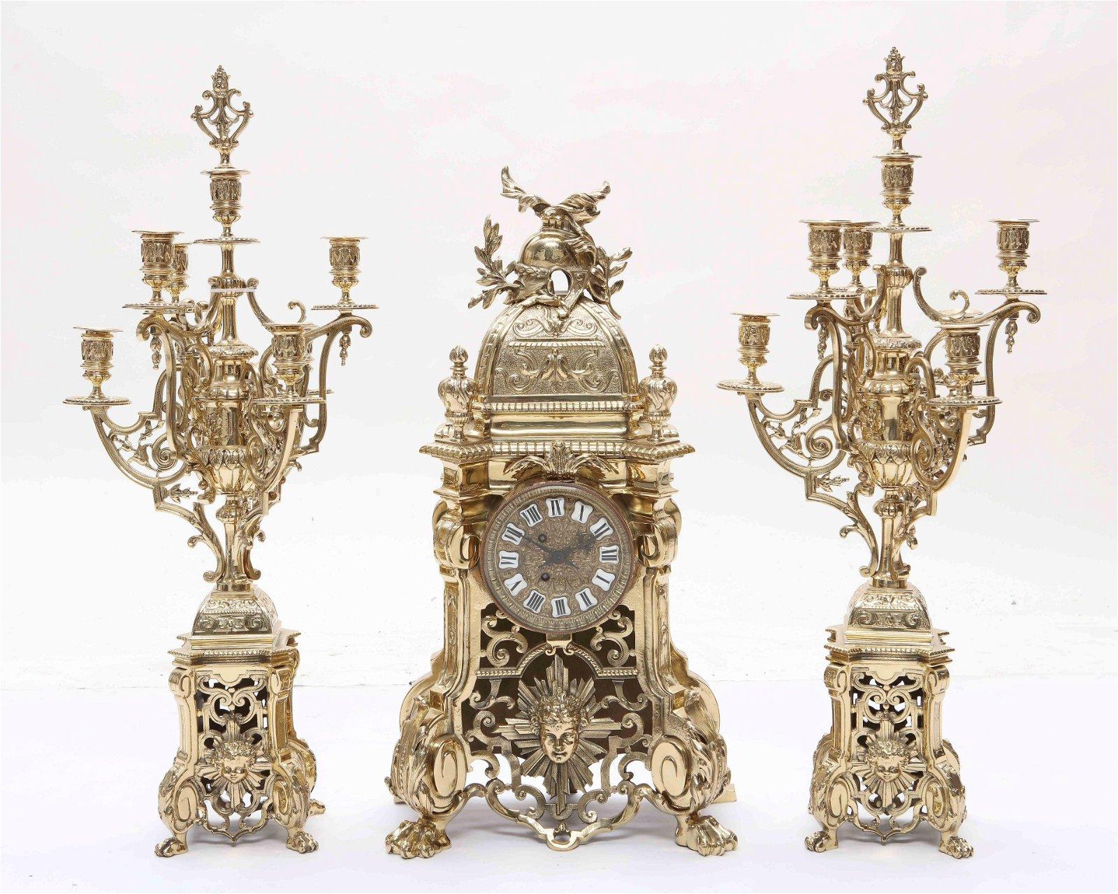Louis XIV style brass three piece clock garniture