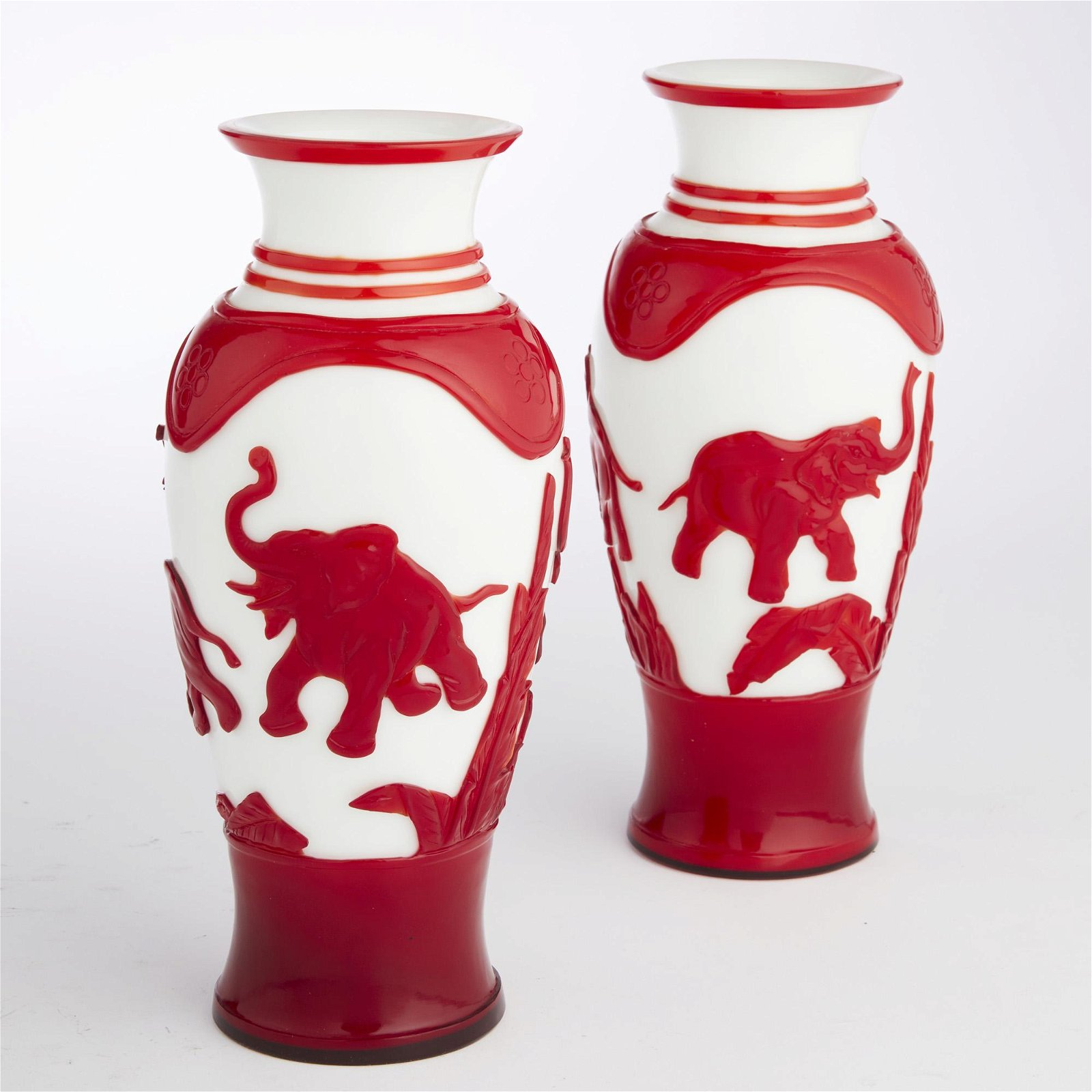 A pair of Chinese red and white Peking glass vases