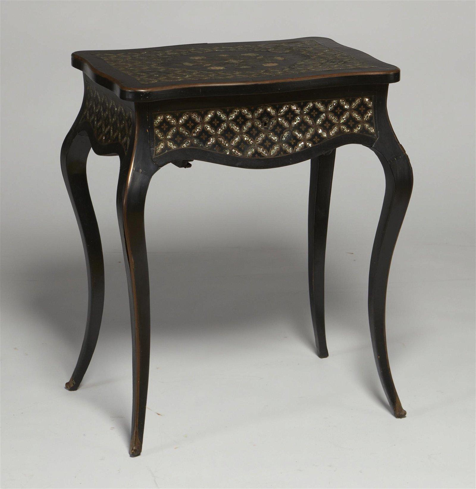 A Napoleon III inlaid ebonized dressing table