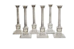 Six George III weighted silver candlesticks