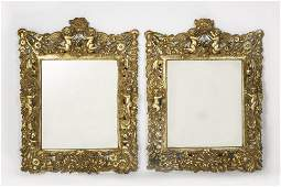 A pair of Charles II style silver gilt mirrors