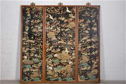 Three Chinese silk embroidered panels, framed largest