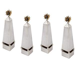Four Tony Duquette silver and brass casters
