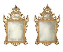 A pair of Italian Rococo style giltwood mirrors