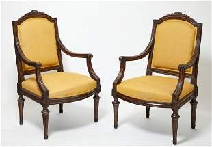 A pair of Italian Neoclassical walnut armchairs