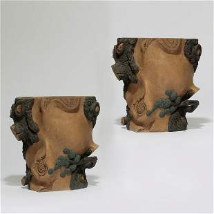 A pair of Chinese glazed pottery wall pockets