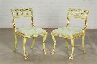 A pair of Neoclassical style green painted chairs