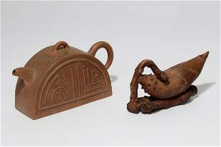 A Chinese yixing pottery teapot & a water dropper