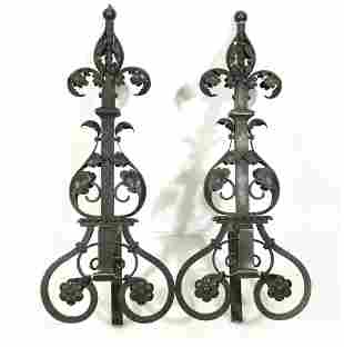 A pair of Baroque style wrought iron andirons