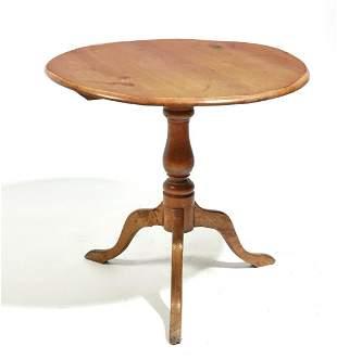 A Continental wood tilt top tripod table