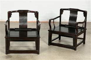 A pair of Chinese hardwood low armchairs