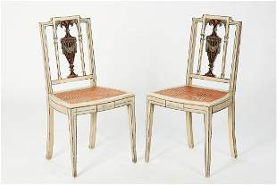 A pair of Neoclassical style painted side chairs