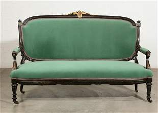 A Napoleon III gilt bronze mounted ebonized settee