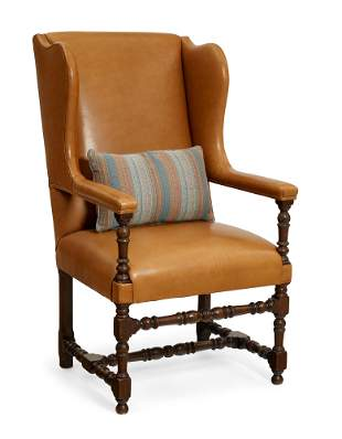 A Continental Baroque style walnut wing armchair