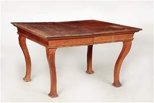 An Art Nouveau oak extension dining table