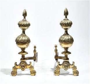 A pair of Continental Baroque style brass andirons