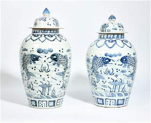 A near pair of Chinese blue & white covered vases