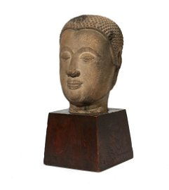 A Chinese sandstone head of a Bodhisattva
