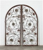A pair of arched wrought iron gates, post 1950