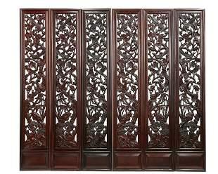 A set of six Chinese pierced hardwood panels