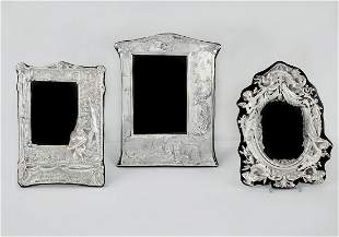 Three sterling silver table top picture frames
