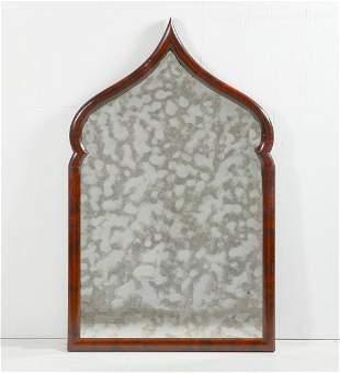A Moorish mahogany arch form mirror