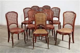 Ten Louis XV style cane paneled walnutchairs