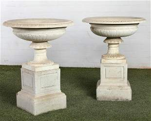 A pair of Italian Neoclassical style  marble urns